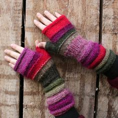 Heather Unmatched Hand Knit Wrist Warmers Fingerless Mittens in upcycled wool and kid mohair. $42.00, via Etsy.