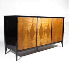 Black Lacquered Diamond Dresser - Stunning walnut dresser / sideboard with symmetrical diamond figuring on front, accented with polished brass pulls. Black lacquer high gloss finish. Two left doors reveal a generous compartment with positionable shelf. Right door reveals three drawers. Black lacquered interior. Front surface is perfectly consistant throughout - our lighting played tricks with the complex flow of horizontal and vertical figuring within the diamond patterns. Beautiful from…