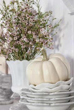 Little French Country Kitchens | couple little pumpkins and gourds tucked on the shelves,