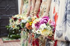 different bouquets for the bridal party? nice idea!