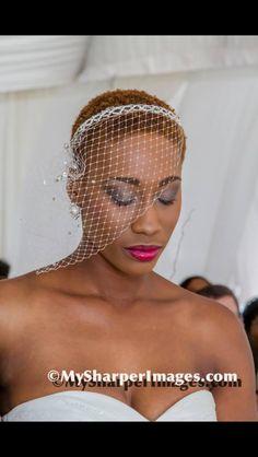 Natural bride. Short natural hair cut. Bird cage veil. Smokey eye and a pink lip.