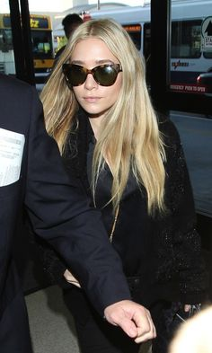 Olsens Anonymous Blog Ashley Olsen LAX Airport Look Long Blonde Hair The Row Cat Eye Sunglasses Embellished Sweater Jeans Croc Tote Bag 2012...