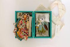 "Artist: Manomine ~ ""Mini Milni can sit, move her little arms & legs. Ms fox comes in a 15cm wooden hand painted box, w a quilt + pillow, 5 dresses, 4 wooden hangers, felt coat, scarf, felt shoulder bag, photo album, felt friend hen Stop, linen picnic rug, linen picnic basket & some felt food: sandwich, croissant, 2 cakes, a wooden bottle of milk & a porcelain tea set for 1."" ~ Even though she is reserved - she is awesome! ~ ♥"