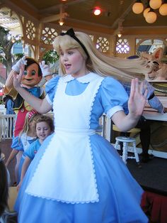 ALICE, looks like she was surprised by a white rabbit at Disneyland. :D