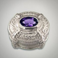 GK Coloures sterling silver slide containing a 7 x 5 millimeter oval cut fancy purple cubic zirconia in an oval etched slide Metal:Sterling Silver Designer:Goldman-Kolber $ 100.00 Item #: 0EP3R1 Call 870-863-8818 for personal consultation.