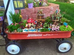 Fairy Garden in an old wagon by Melanie Cantrell. No page to go to, just a photo for ideas & inspiration.