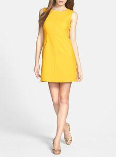 Yellow for spring! Classic cut woven sheath dress by Diane von Furstenberg.
