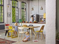 Thanks to open kitchens like this one, you can simultaneously cook and watch your children play.