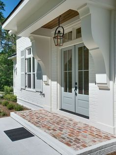 Blue door and blue shutters Custom Homes Rustic Shutters, Exterior Design, Home, House Exterior, Custom Homes, House Painting, New Homes, Exterior, Exterior House Colors