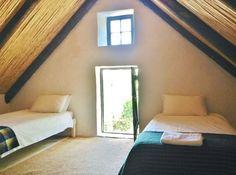 The loft bedroom in The Little Farmhouse.