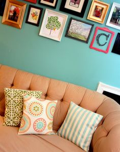 turquoise wall, frames, cushions