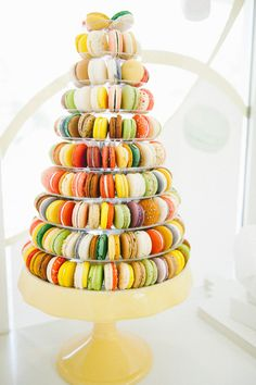 Macaron tower with rainbow colours! Such a fun way to add 'wow' to any dessert table or event. Easy to customize with flavours & colours! #yannpins #macarons #tower