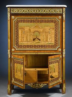 Remarkable secretaire with colorful marquetry in rosewood, amaranth, stained holly & mother of pearl.  MS Rau Antiques in New Orleans, Louisiana.