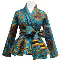 Style Stand out in our beautiful Diola African print blazer. This African print blazer features a teal and yellow African print, with a slimming peplum style fit. Pair this blazer perfectly wi African Inspired Fashion, African Print Fashion, Africa Fashion, African Print Dresses, African Fashion Dresses, African Dress, African Prints, Ankara Fashion, African Tops
