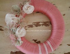 from craftsncoffee.com and kellyhicksblog.com  Those fabric flowers are pinned on; would be easy to replace each season!