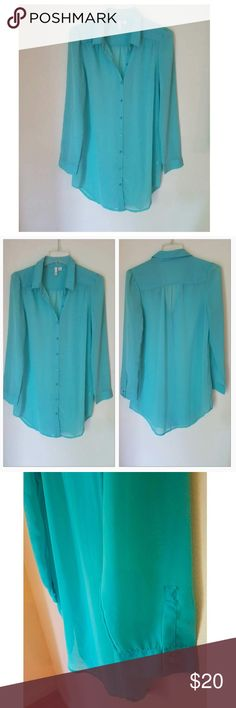 Versatile Perfect Hi-Low Button Up Versatile Button up Blouse with a cute mini baby ruffle on the shoulders. Long enough to be a swimsuit cover or you can style with a belt and leggings. Tuck it in when it's time to go to work  *3/4 Quarter Sleeve  *Mini High Low  *Color: Mint Green  *Front Button Up *Size: Medium  *Sheer  *2 Buttons on Each Sleeve  *Never Worn / Perfect Condition Tops Button Down Shirts