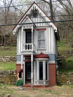 ... I would paint all the rooms the most gorgeous colors, never worrying about resale value!  I'd also plant flower gardens everywhere, with lots of bird baths and hummingbird feeders. BTW, I adore the window on the bottom right! (Tiny house in Eureka Springs, AR.0