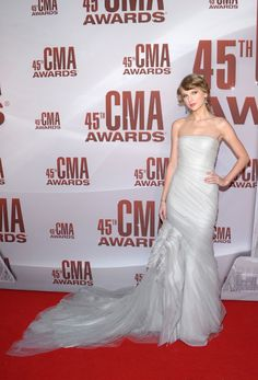 Taylor Swift strikes a pose on the red carpet at the 45th annual CMA Awards in Nashville on Nov. 9, 2011.