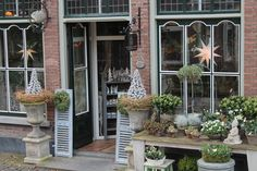 free standing french doors as entry to wedding reception tent with wine barrels and beautiful flowers Store Front Windows, Chic Shop, Shops, Storage Places, Store Fronts, New Shop, Ladder Decor, Sweet Home, Table Decorations