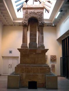 Ghirza Mausoleum, currently housed at Assaraya Alhamra Museum in Tripoli, Libya. The name Ghirza appears in several place-names of classical times, such as the Roman civitas Gurzensis and the Gurza of Ptolemy. Its chief Sun-God Ghurza, mentioned as Gurzil by Corippus, and Kurza by al-Bakari (11th century CE), was a prophesy god, whose faceless body was said to represent the image of the deceased in a seated position. THE LIBYAN Esther Kofod www.estherkofod.com