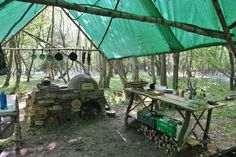 Off-grid woods kitchen at hunter:gather:cook - good idea for a camping kitchen - set up a prep table and a dining table and you have a nice cover to keep off the morning dew or other weather