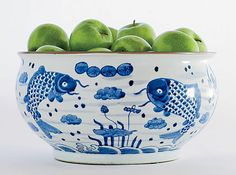 blue and white Chinese bowl filled with green apples