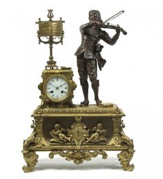 A French Gilt and Patinated Metal Figural Mantel Clock: