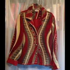 PARSLEY & SAGE JACKET A beautiful jacket  heavy ribbon stitches around all edges. This is a heavy fabric;  55% cotton & 45% rayon. This garment is fully lined, roll up sleeves makes a soft  faux cowhide cuff. The boltons are silver and copper tone weave pattern. Size:  L, Breast: 20 side/side, length:  24 in. Sleeves: 22 in. cuffed & 24 in. uncuffed.  This is in good condition PARSLEY & SAGE Jackets & Coats Blazers