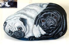 Portrait of two pugs painted on a rock by sassidipinti, via Flickr