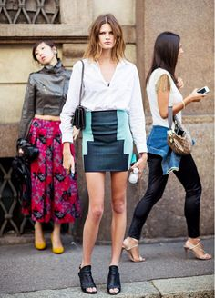Work a miniskirt like an off-duty model by pairing it with a worn-in shirt and minimal accessories // #StyleTip #StreetStyle