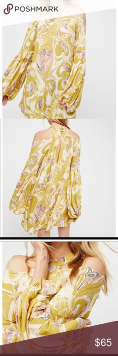 Free People Dress Free People drift away bold printed dress. cold shoulder high neck snap. Wide sleeves with pleated detailing and slit in the back. Brand new with tags. Free People Dresses Mini
