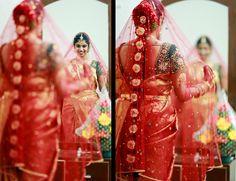 South Indian bride. Temple jewelry.Red Silk kanchipuram sari with contrast green blouse. Braid with fresh flowers. Tamil bride. Telugu bride. Kannada bride. Hindu bride. Malayalee bride