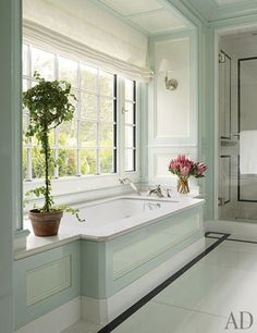 What a lovely place to take a bath with a roman shade for privacy that doesn't interfere with the space. #CLinspirationmonday CHRISTOPHER MAYA INC