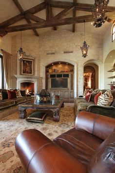 chenoah & jay:  add faux beams to family room for that tuscan feel...plus I love the big rustic coffee table.  Adds so much character.