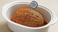 Make this ham recipe your go-to party dish—made with just four ingredients and requiring minimal prep time, it's the easiest holiday ham ever! Whether serving it to a crowd during the holidays or making it for a special family meal, this flavorful recipe is a guaranteed hit. Cooking the ham in the slow cooker keeps it moist and flavorful without fear of drying out, and the maple-brown sugar mixture makes a fantastic sauce to serve with the ham.