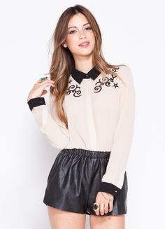 """This collared shirt features star and stud detail to give it the perfect combination of girly and edgy.  100% polyester 24"""" length Model is wearing size S"""