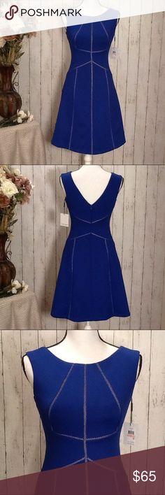 NWT $134 Calvin Klein Dress Size 2 Royal Blue Beautiful dress by Calvin Klein, size 2, NWT, $134, stunning royal blue color with cream/tan stitching stripes (this color is solid, not see-thru to show skin just in case it appears this way), hourglass fit, flowy bottom, back zipper for easy pull on fit. Approx measurements: length from top of arm pit to bottom, 27 in, bust 32-34, waist, 26 in, hips, 36 in (refer to Calvin Klein's fit size guide for size 2 dress). Bundle to save 15% off your…
