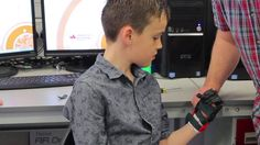 3D printed hand adapted for eight-year-old boy born with no fingers - BBC News