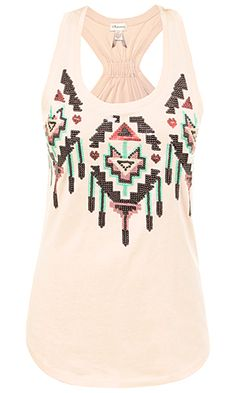We have this shirt at my work y'all! In black with green an purple sequins. They're to die for!
