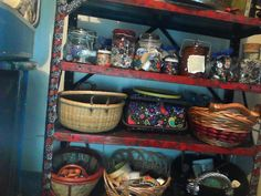 storage in my craft room.  top shelf is assorted bottles with bits and pieces.  Baskets hold bigger items.