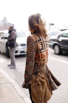 Love the peplum on the tribal print coat and the draw string bag ♥