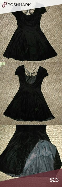 Black velvet retro flare dress This cute little black dress is simple with a great bit of bling in the back! Built in petticoat along the bottom, invisible zipper along the side. Worn once, like new. Says size 9-10 on label, but fits me and I'm a women's Medium Zum Zum Dresses Midi