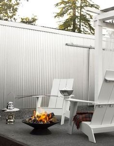 Galvanized fence and sliding gate = cool look!