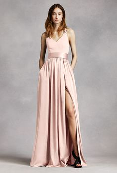 Brides.com: . V-neck halter gown with sash, $179.95, White by Vera Wang available at David's Bridal