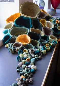 Jennifer E Moss- Installation with hand dyed felt. The colors come from turmeric, spinach and black beans.