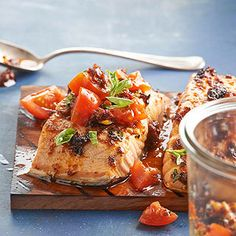 Salmon with Tomato Pesto From Better Homes and Gardens, ideas and improvement projects for your home and garden plus recipes and entertaining ideas.