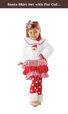 Santa Skirt Set with Fur Cuff (4T). Your little princess will be ready for Santa in this outfit from Mud Pie's Santa Baby Collection. This 2 piece set starts with a shirt featuring a dimensional Santa applique. Santa has a soft, shag chenille beard. Shirt has a wide ruffle collar and flared sleeves that are trimmed with red pom-poms. Rounding out this outfit is the tiered skirt and coordinating polka dot leggings. Festive faux-fur cuffs at the legging's bottoms. Leggings are built-in to…