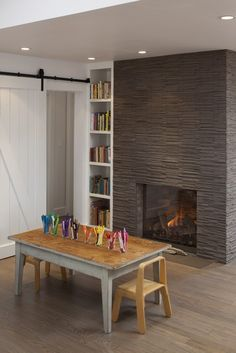slider, fireplace, and art table...love