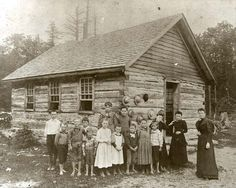 Teacher and a one room school with bare foot students, Michigan 1880