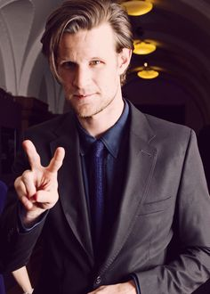 Matt Smith in all his hipster glory--his hair is back, his chin (blimey) is scruffy... mm-mmm